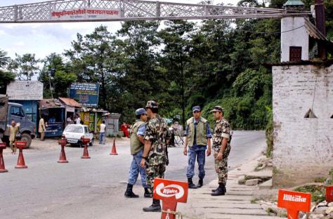 IMAGE: Soldiers guard a checkpoint out of Katmandu, Nepal.