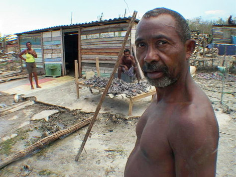 Manuel Camacho outside his wrecked home in Cajio, Cuba.