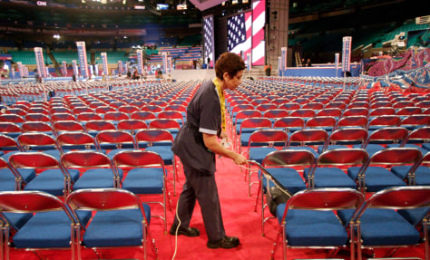 IMAGE: WORKER ON CONVENTION FLOOR