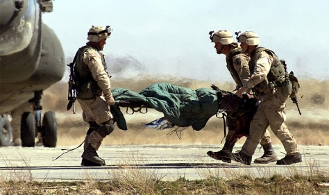FILE PHOTO: US SOLDIERS IN BAGRAM CARRY INJURED PRISONER