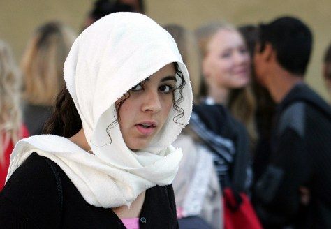 A student wearing Islamic headscarf arrives at start of school year in northern France