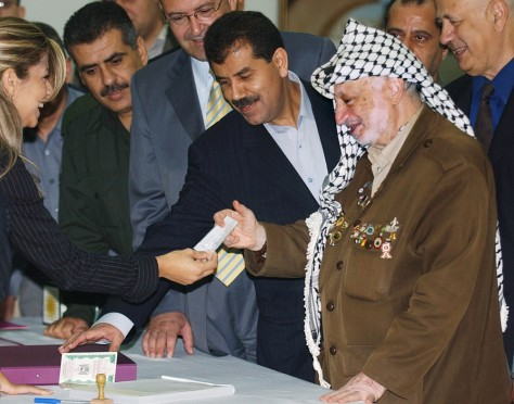 Image: Yasser Arafat receives voter registration card.