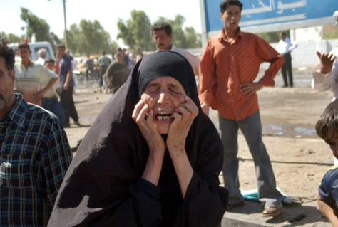 WOMAN CRIES AT BOMBING SITE