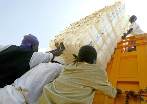 Sudanese relief workers load a truck wit