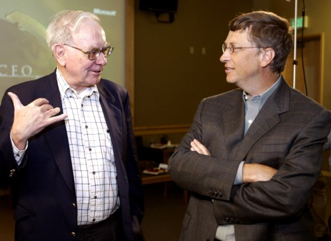 BILL GATES OF MICROSOFT TALKS TO WARREN BUFFETT AT CEO SUMMIT