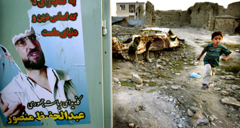 Image: Afghan child wades through ruins