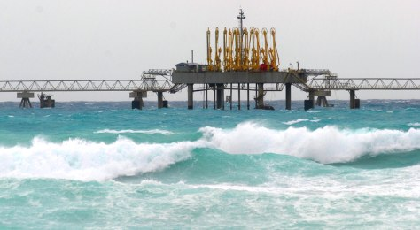 Image: Waves pound oil facilities