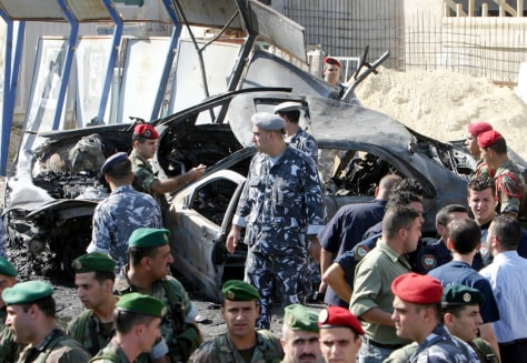 Image: Lebanese security inspect damaged car.