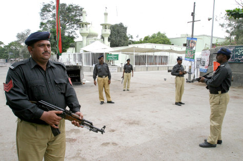 Image: Pakistani policemen guard a mosque.