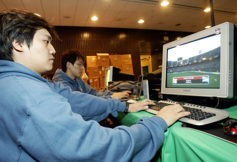 Workers set up game systems for competition