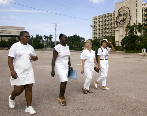 Wives of jailed Cuban dissidents walk on Revolution Square