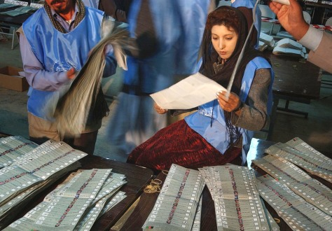 Image: Afghan election workers count ballots.