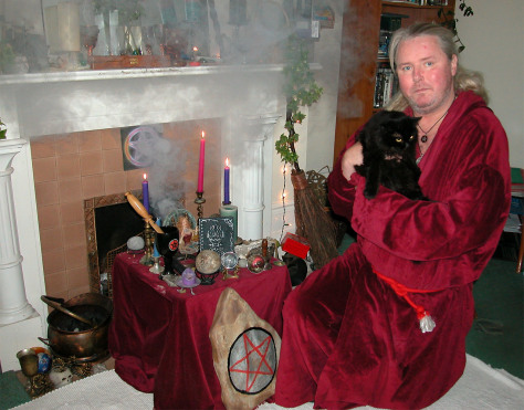 Image: High Priest of British White Witches Kevin Carlyon with black cat.