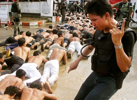 Image: Police arrest Thai demonstrators.