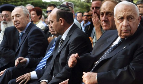 IIsraeli Prime Minister Ariel Sharon sits with cabinet ministers at Rabin memorial in Jerusalem