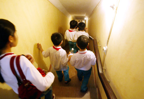 VIETNAMESE SCHOOLCHILDREN VISIT SITE OF FORBIDDEN CITY AND MILITARY BUNKER
