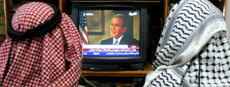 PALESTINIAN WATCH PRESIDENT BUSH'S INTERVIEW ON TV IN HEBRON