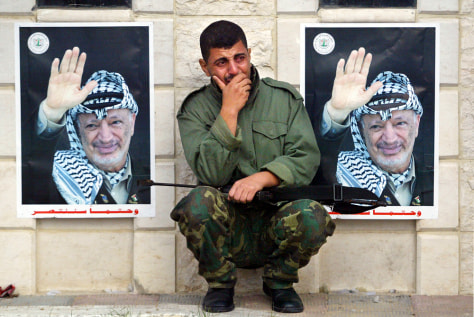 IMAGE: Palestinian guard weeps