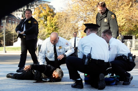 Image: Secret service officers surround man who set himself on fire.