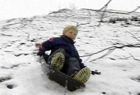 BOY SLEDS IN CALIFORNIA TOWN