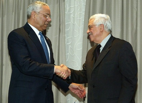 US Secretary of State Powell shakes hands with PLO chief Mahmoud Abbas in Jericho