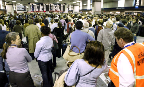 Image: Delayed passengers wait at New York's Pennsylvania Station.