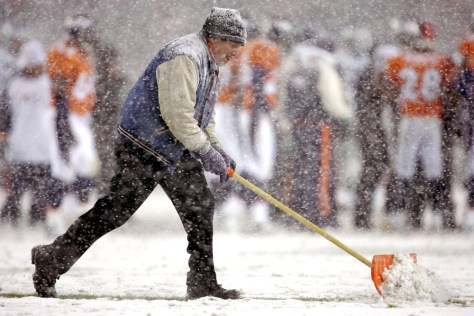 SHOVELING SNOW AT FOOTBALL GAME