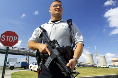 Guard stands in front of nuclear plant