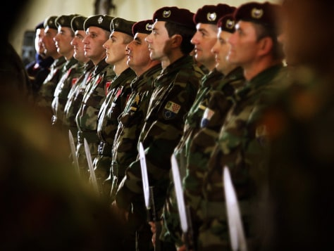Soldiers of two Bosnias armies stand guard together during a ceremony in Sarajevo