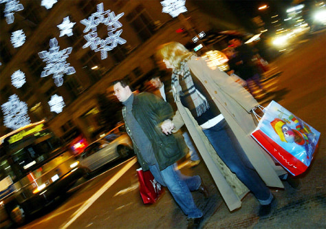 Shoppers cross Fifth Avenue in New York City