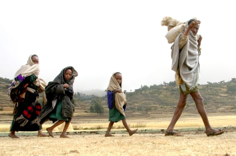 An Ethiopian family walks near Korom northeast Ethiopia