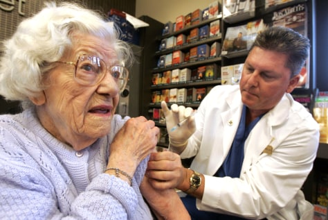 Woman receives flu shot