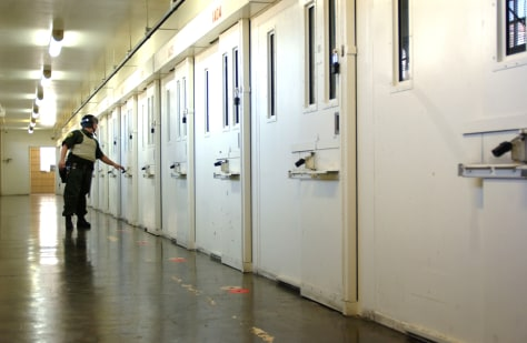 FILE PHOTO: Guard checks doors at San Quentin prison