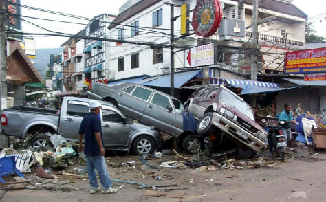 Cars are piled on top of each other in Phuket, Thailand in the tsunami's aftermath