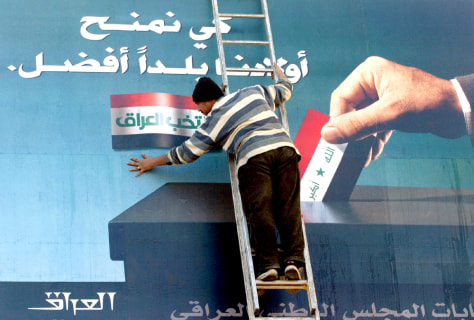 Billboard urging Iraqis to vote is prepared in Baghdad