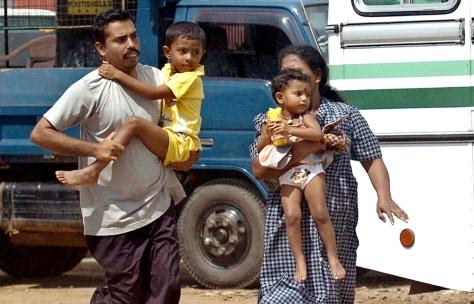 Image: Sri Lankan family flees.