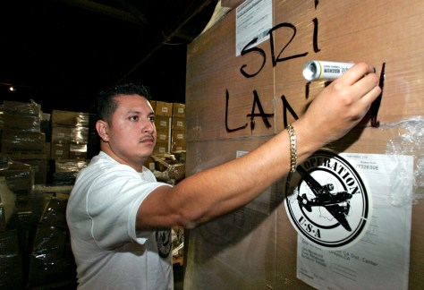 Image: Man prepares box for shipment to Sri Lanka.