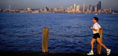 Image: Jogger in front of Seattle skyline.