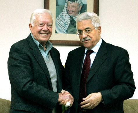 Newly elected Palestinian President Mahmoud Abbas meets with former U.S. president Jimmy Carter in his office in the Muqata compound in the West Bank city of Ramallah