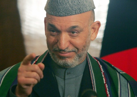 Afghan President Hamid Karzai gestures during a news conference in Kabul