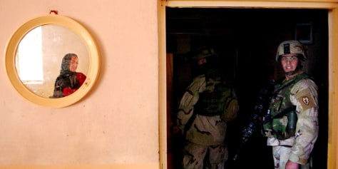 Image: U.S. soldiers in Iraqi woman's home.