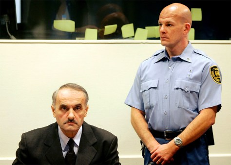 Former Bosnian Serb army commander Vidoje Blagojevic waits in the courtroom in The Hague
