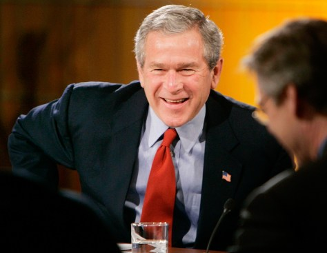 US President Bush laughs during White House Economic Conference in Washington