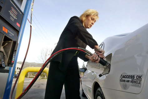 WOMAN REFUELS HER NATURAL GAS CAR