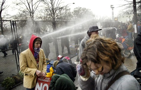 Police fire pepper spray into crowd of protestors as Bush inaugural parade passes