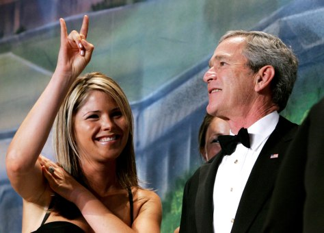 BUSH WITH DAUGHTER JENNA, WHO FLASHES LONGHORN SIGN