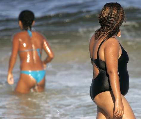 An obese Brazilian woman walks on Copacabana beach in Rio de Janeiro