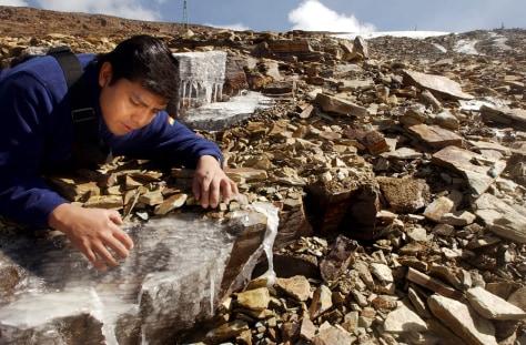 BOLIVIAN GLACIOLOGIST EXAMINES ROCKS