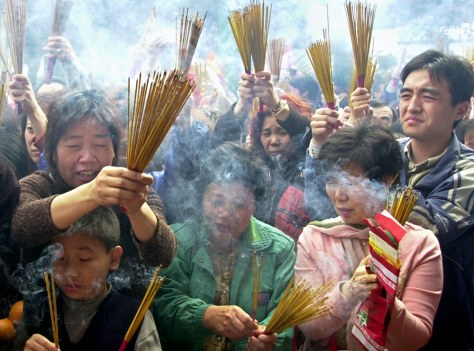 Image: Hong Kong worshippers burn incense.