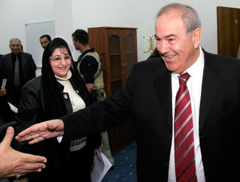 Iraqi interim Prime Minister Allawi greets supporters in Baghdad